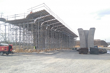 Precast slab prefabrication for load-bearing tower system support